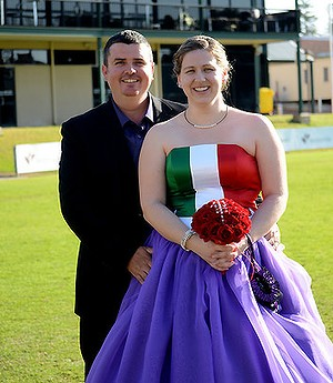 Dave and Gemma Spencer renewed their vows at a Dockers-themed wedding at Fremantle Oval in August 2012. Photo: SophistiKated Photography.